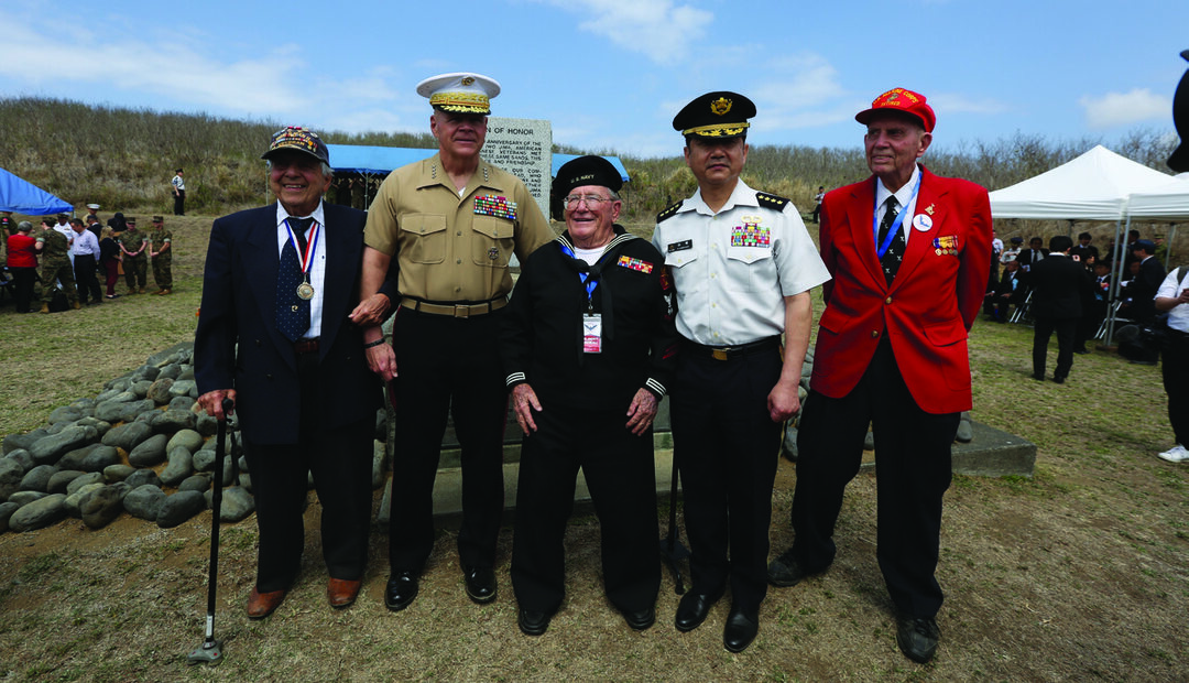 Then-Commandant of the Marine Corps Gen. Robert B. Neller, second from left, and Japanese Chief of the Ground Staff Gen. Koji Yamazaki, second from right, pose for a photo with veterans before a ceremony on the island, March 23, 2019. Neller and other distinguished U.S. and Japanese leaders were there to commemorate the Reunion of Honor during the 74th anniversary of the Battle of Iwo Jima. U.S. MARINE CORPS PHOTO BY SGT. OLIVIA G. ORTIZ