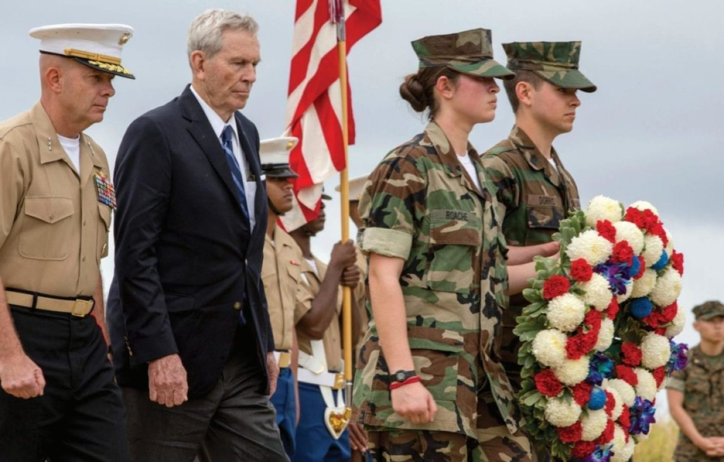 Young Marines approach an Iwo Jima memorial to participate in a wreath-laying presentation as part of the 72nd Reunion of Honor ceremony, March 25, 2017. This event presented the opportunity for the U.S. and Japanese people to mutually remember and honor thousands of service members who fought and died on the hallowed grounds of Iwo Jima. U.S. MARINE CORPS PHOTO BY LANCE CPL. BROOKE DEITERS