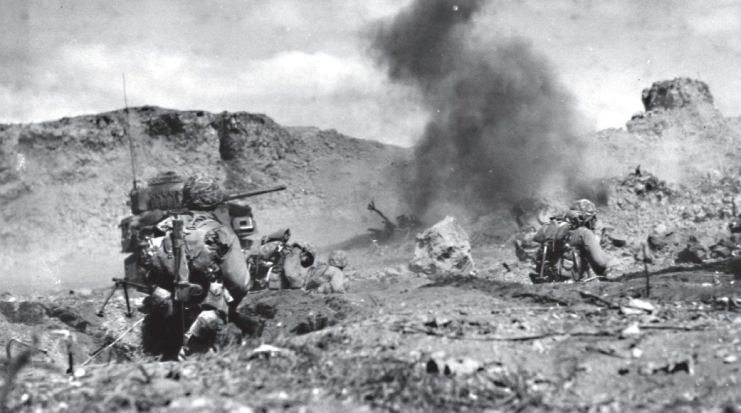 Marine infantry and tanks attack Japanese positions on rocky northern Iwo Jima during a direct frontal assault. The explosion seen is an enemy mortar shell. This advance gained 20 yards at a cost of 30 Marine casualties. U.S. MARINE CORPS HISTORICAL CENTER