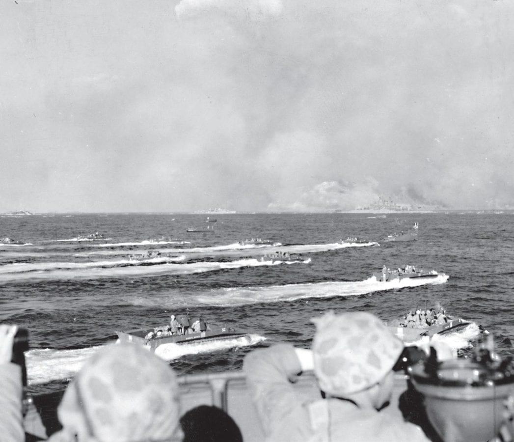 LVTs carry Marines toward Iwo Jima on D-day.