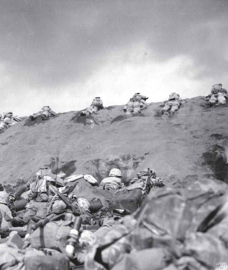 Marines under fire on Red Beach No. 1. Iwo Jima