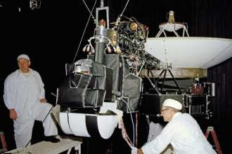 Picture of NASA engineers assembling the Voyager satellite from 1977 which contained critical microwave communication equipment powered by EEC's samarium cobalt magnets produced in Lancaster, PA (Image courtesy of Electron Energy Corporation)