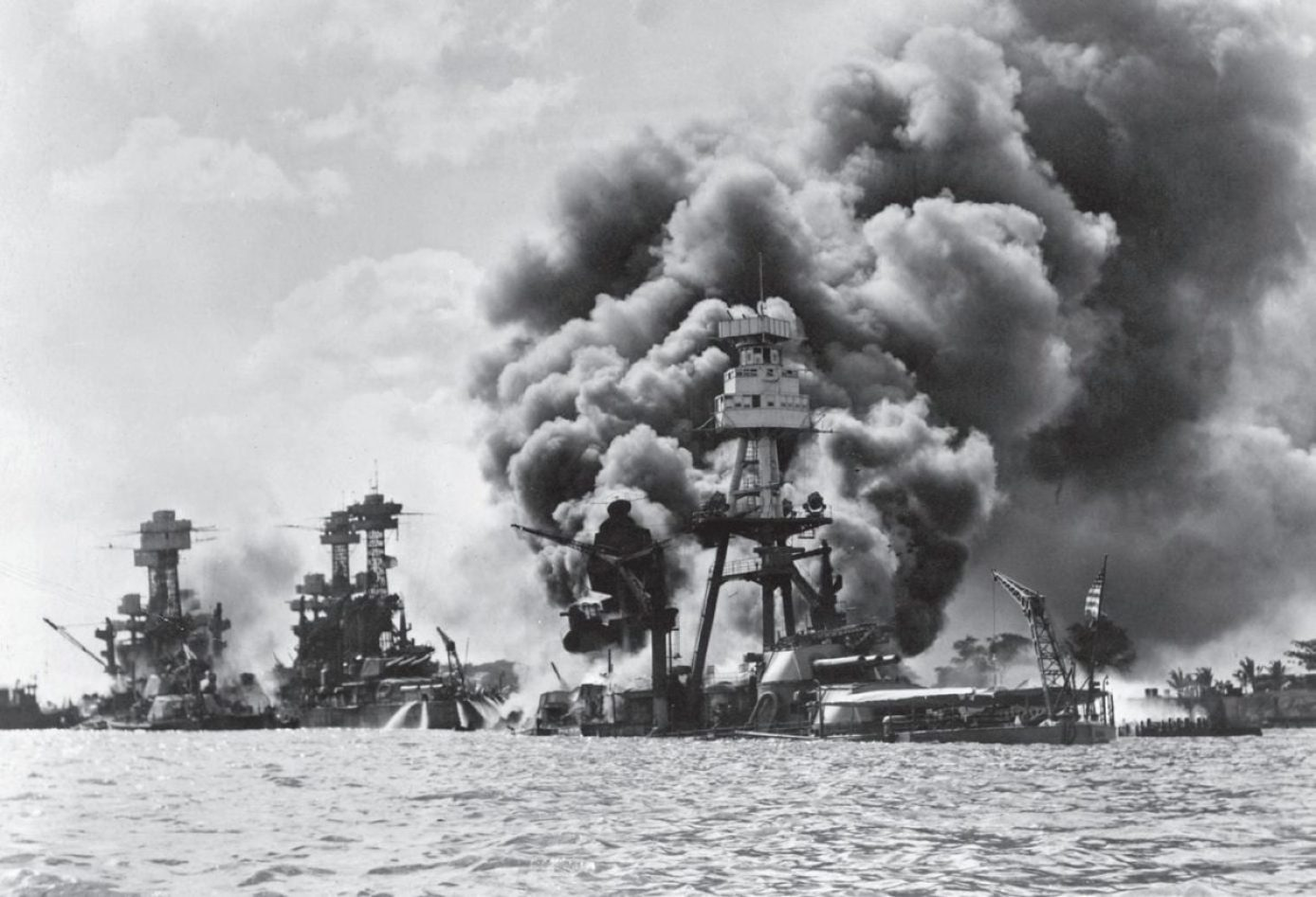 The Pacific Fleet's battle line burns at Pearl Harbor. War Plan Orange's original incarnation, where the fleet would sail for a decisive battle with the Japanese after which the Philippines would be relieved, was rendered moot by the attack. It was replaced by War Plan Rainbow 5, based in large part on a pre-war strategy developed by Marine Corps visionaries. National Archives Photo