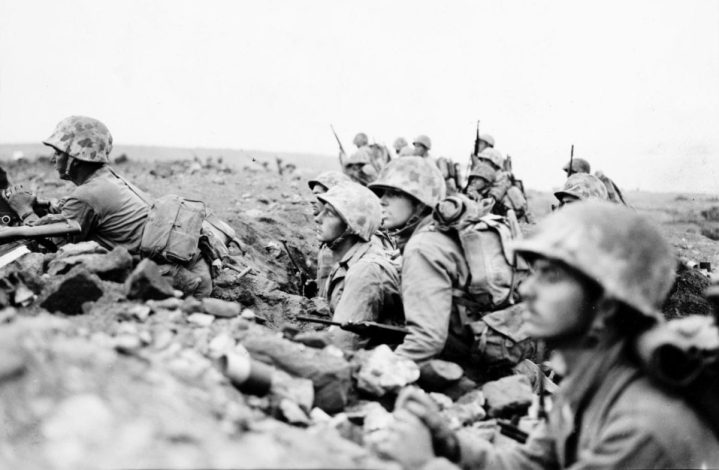 The 24th Marines prepare to attack Motoyama Airfield No. 1 Feb. 20, 1945, at H-hour, 0900, 500 yards inland from Yellow 2 Beach. U.S. MARINE CORPS HISTORICAL CENTER
