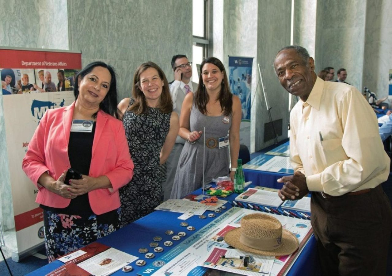 Sumitra Muralidhar, PhD, far left, is pictured at the 2018 VA Research Fair on Capitol Hill. Muralidhar directs the Million Veteran Program.