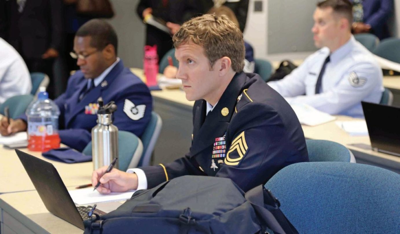 Army Sgt. 1st Class Joshua Richter listens to a lecture at George Mason University-Prince William Campus, Manassas, Virginia, as a student in the Uniformed Services University of the Health Sciences' Enlisted to Medical Degree Preparatory Program in 2014. Richter was among the first 10 enlisted members accepted into the program, which has expanded each year since it began.