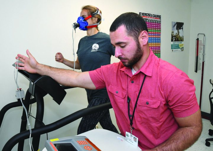Kale Panetti, a health educator at the Fort Drum Army Wellness Center, administers a VO 2 max assessment that tells clients how well their muscles use oxygen. Army Wellness Centers can provide soldiers with scientifically validated assessments and personalized plans for how they can improve components of their health and performance.