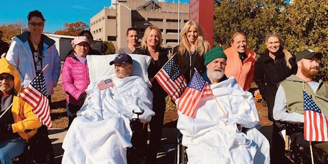 VA spinal cord injury (SCI) nurses and veterans on Veterans Day Weekend at the VA Boston Healthcare System. Staff shortages in specialty care areas can lead to overworked staff and delays in veterans' access to care.