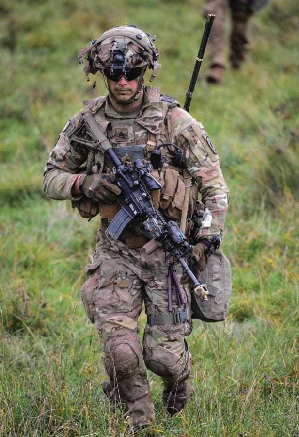 A U.S. Army paratrooper assigned to the 173rd Airborne Brigade runs to the woodline after conducting an air assault mission during Exercise Saber Junction 2019 in Hohenfels Training Area, Germany, Sept. 26, 2019. Army Wellness Centers are using research combined with technology, health promotion, and wellness programs to minimize soldiers' musculoskeletal injury risk and help them achieve warfighting readiness.
