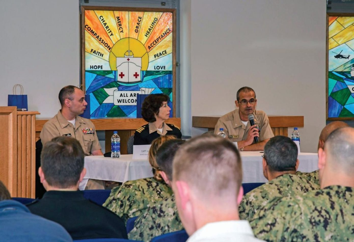 Naval Medical Center Portsmouth (NMCP) hosted the Future of Military Medicine panel on Nov. 14, 2019, to discuss the MTFs' transition to DHA. The panel participants were, from left to right: Capt. Joel Schofer, deputy chief of the Medical Corps at the Navy Bureau of Medicine and Surgery (BUMED); Capt. Lisa Mulligan, NMCP's commanding officer; and Capt. Guido Valdes, Navy Medicine East's deputy commander.