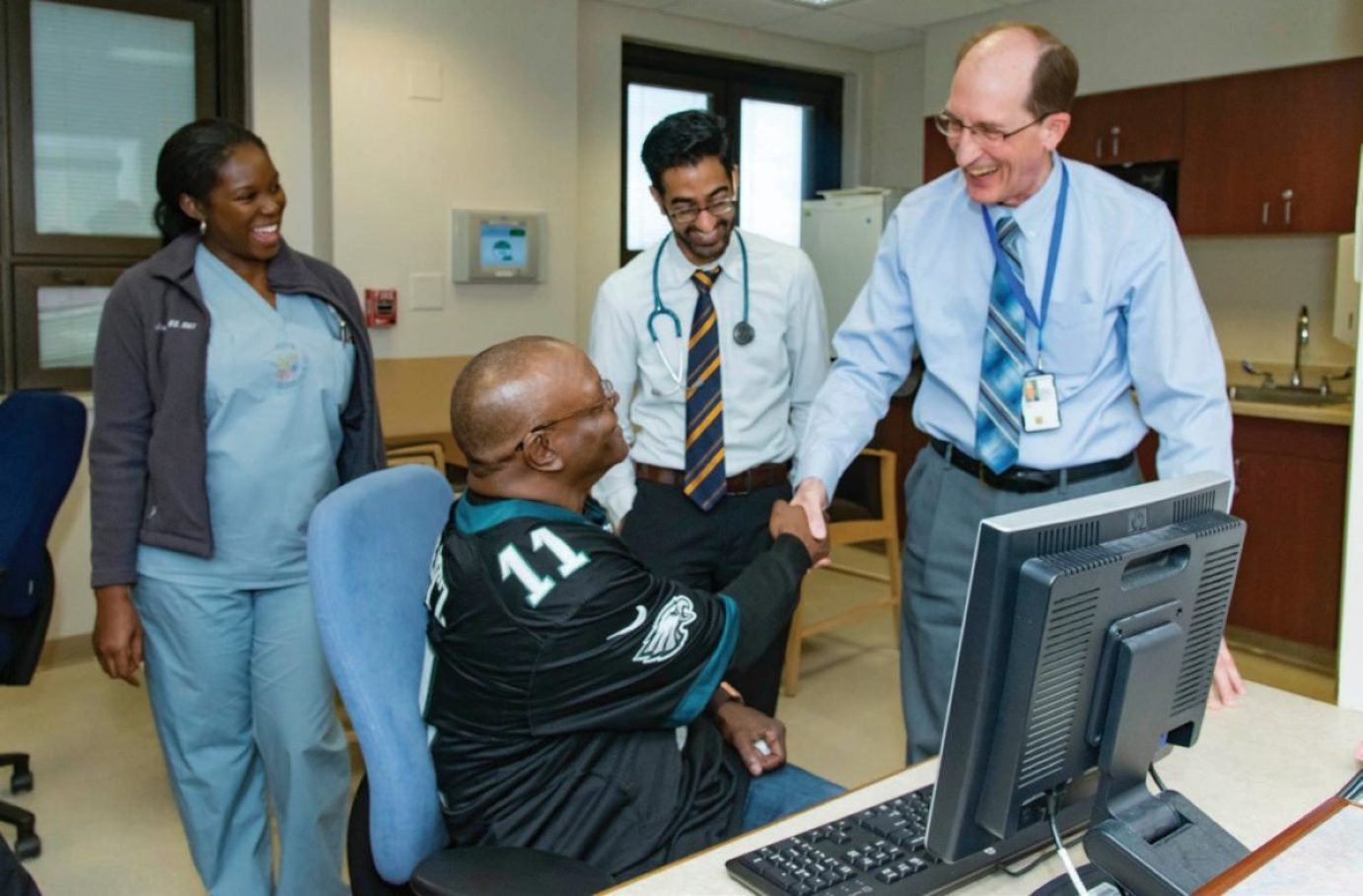 Samuel Kuna, MD, VA physician and director of the Crescenz VA Sleep Center, pictured at right, discusses the benefits of the REVAMP app, which enables veterans to play a primary role in tracking sleep data and adjusting sleep habits to mitigate the effects of obstructive sleep apnea, with Army veteran Walter Broadnax at the Corporal Michael J. Crescenz VAMC. Kuna, who led the development of REVAMP, is a core investigator with the VA Center for Health Equity Research and Promotion (CHERP), and in 2012 was awarded a VA Employee Innovation Award to translate his research into practice. In August 2017, REVAMP launched as a pilot at 10 sites across the country and has since expanded to additional sites within the VA health care system.