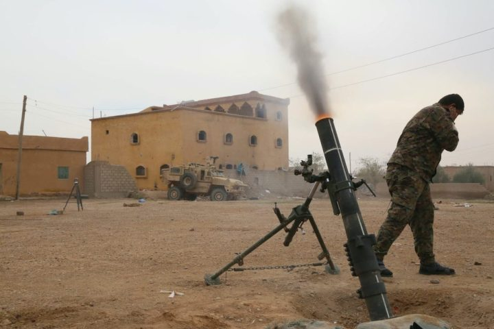 A Syrian Democratic Forces (SDF) member fires a 120mm round in southwest Asia Nov. 19, 2018. Coalition and partner forces work together during mortar fire missions targeting ISIS pockets in northeast Syria. (Photo by U.S. Army Spc. Christian Simmons)