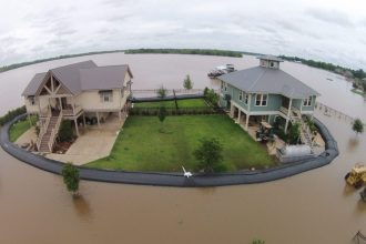 In 2015, 500 feet of 3-feett tall AquaDams were deployed around the perimeter of two neighboring homes in Natchitoches, LA. (AquaDam image)