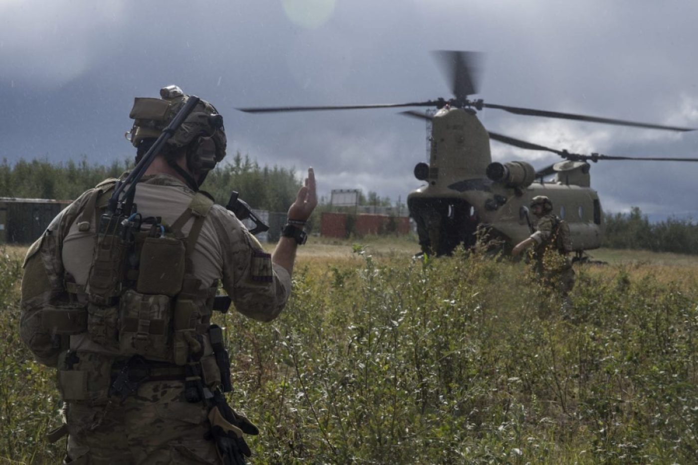A Special Tactics Airman with the 17th Special Tactics Squadron watches as a U.S. Army CH-47 Chinook prepares to land during RED FLAG-Alaska 18-3 at Eielson Air Force Base, Alaska, Aug. 16, 2018. Special Tactics is U.S. Special Operation Command's tactical air and ground integration force, and the Air Force's special operations ground force, leading global access, precision strike, personnel recovery and battlefield surgery operations. (U.S. Air Force photo by Tech. Sgt. Sandra Welch)