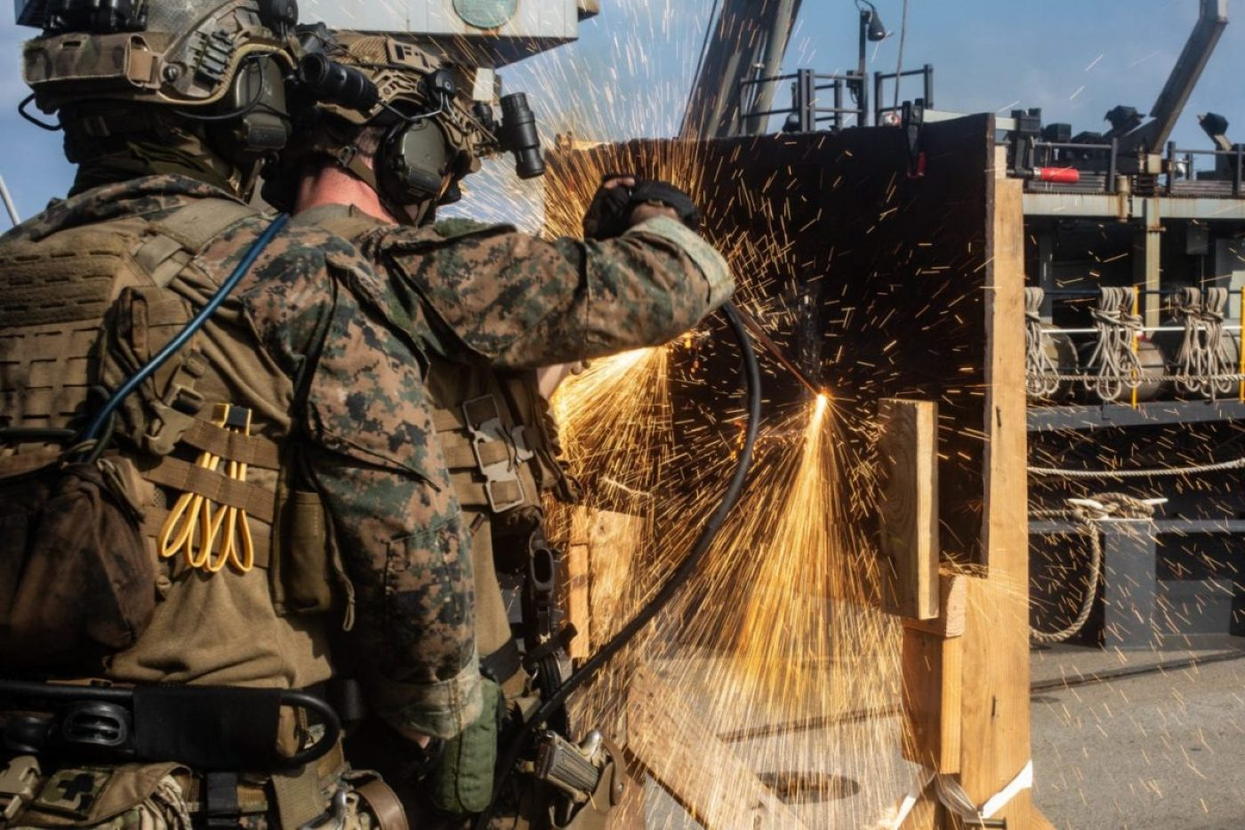 Force Reconnaissance Marines with Command Element, 31st Marine Expeditionary Unit (MEU), cut through metal during a simulated VBSS mission drills aboard dock landing ship USS Germantown (LSD 42). (U.S. Marine Corps photo by Lance Cpl. Kolby Leger).