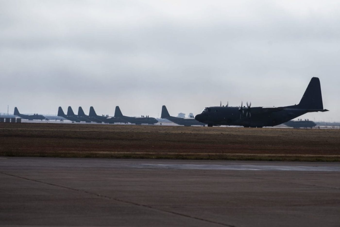 An AC-130W Stinger II gunship, Tail No. 1303, right, taxis the runway at Cannon Air Force Base, N.M., before its final flight prior to retirement Oct. 19, 2020. The Air Force received the aircraft from the Lockheed-Martin factory June 6, 1989, with the original nickname of 'City of Hurricane.' (U.S. Air Force photo by Staff Sgt. Luke Kitterman)