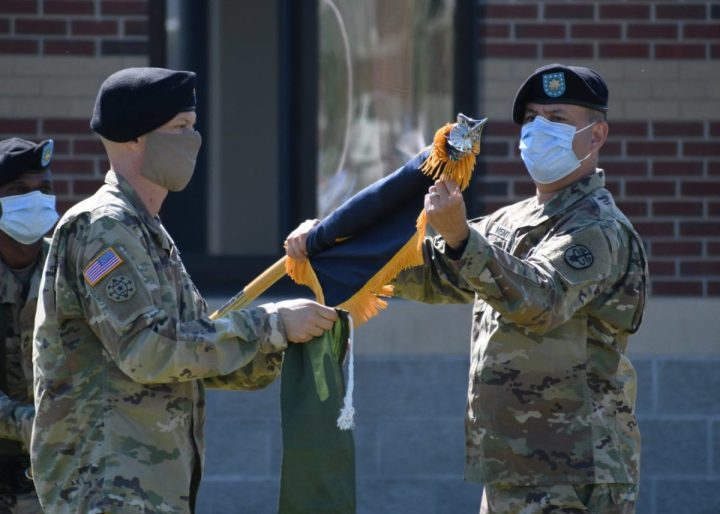 Lt. Col. Robert P. Venton (right) and Command Sgt. Maj. Gordon Lawitzke (left), the commander and senior enlisted leader respectively of the Fort Drum Soldier Recovery Unit, prepare to case the iconic colors of the 3rd Battalion, 85th Mountain Infantry Regiment Warrior Transition Unit (WTU) during a re-designation ceremony on Fort Drum, N.Y. June 16, 2020. The WTU was re-designated the Fort Drum Soldier Recovery Unit as part of the Army's restructuring of the Warrior Care and Transition Program to the Army Recovery Care Program. The new model of wounded warrior care will simplify entry criteria, streamline processes and focus resources to foster an environment that will serve individual wounded, ill and injured Soldiers. (U.S. Army photo by Warren W. Wright Jr., Fort Drum Medical Activity Public Affairs)