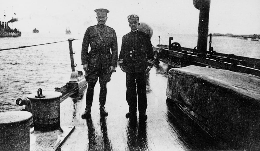 Gen. John J. Pershing and Rear Adm. Albert Gleaves on the deck of USS Seattle in the harbor of Brest, France, 1918. The Spanish flu was transported across the Atlantic on troopships, and some 12,000 troops actually died of the flu while aboard them.