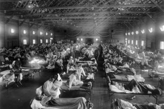 Military patients in an emergency hospital in Camp Funston, Kansas, in the midst of the Spanish flu pandemic. Camp Funston recorded the first military case of the Spanish flu on March 4, 1918.
