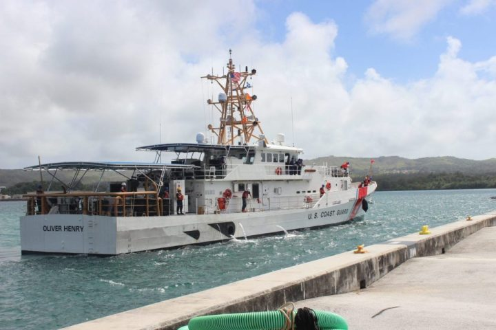 The crew of the Coast Guard Cutter Oliver Henry (WPC 1140) arrives at the cutters new homeport in Santa Rita, Guam, Nov. 30, 2020. The Oliver Henry is the second of three scheduled Fast Response Cutters (FRC) to be stationed in Guam. (U.S. Coast Guard photo courtesy of Petty Officer 3rd Class Katherine Hays/Released)