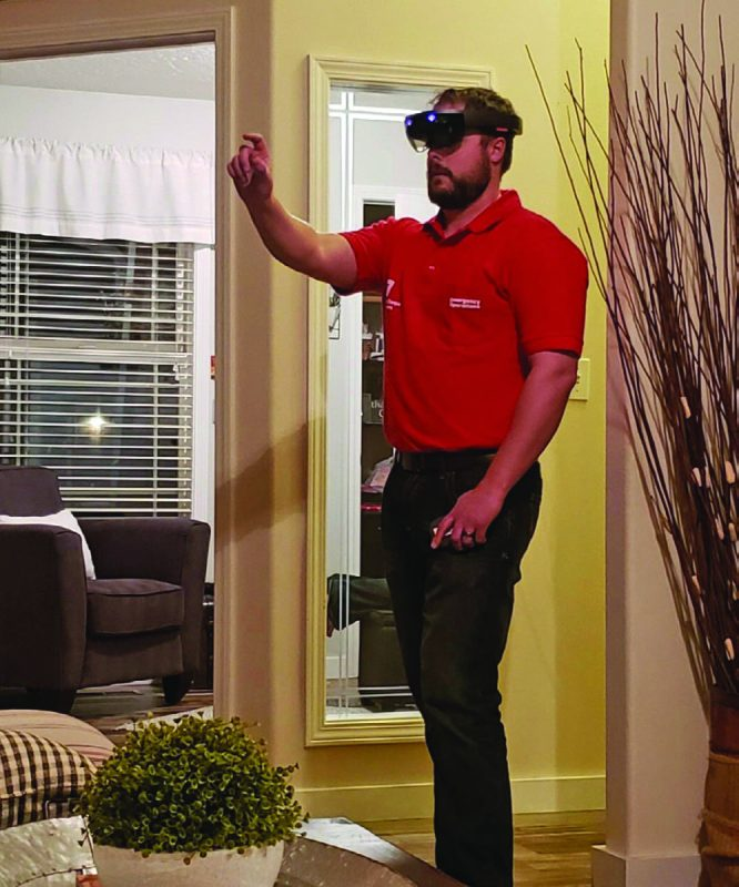Caleb Willard, an engineer with the U.S. Army Corps of Engineers Walla Walla District, uses augmented-reality tools developed at the U.S. Army Engineer Research and Development Center to assess a potential site for a COVID-19 alternate care facility (ACF) while working from home in April 2020. (ERDC photo)
