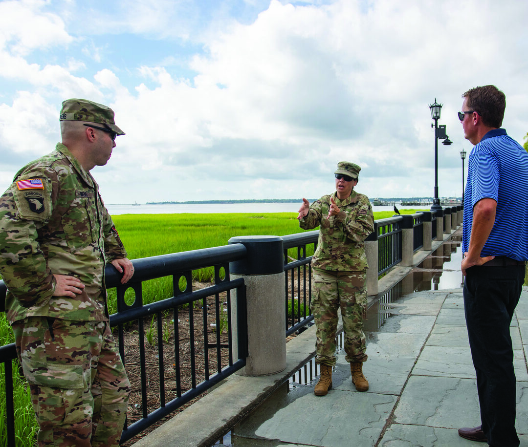 Left to right, Maj. Joe Owens, Lt. Col. Rachel Honderd, and Wes Wilson walk through Waterfront Park in downtown Charleston, discussing aspects of the Charleston Peninsula Coastal Flood Risk Management Study, which aims to provide a feasible solution to addressing coastal storm risk in the downtown area. (Photo courtesy Charleston District)
