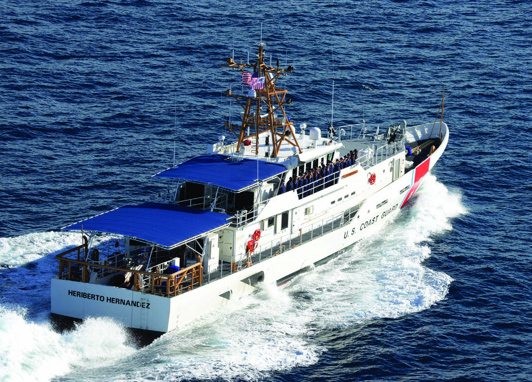 The crew of the Coast Guard Cutter Heriberto Hernandez salutes for a photo off the coast of Key West, Florida, Sep. 10, 2015. Heriberto Hernandez was a Coast Guardsman killed in action during the Vietnam War on Dec. 5, 1968. (U.S. Coast Guard photo by Petty Officer 2nd Class Mark Barney)