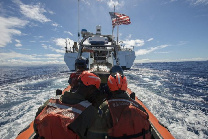Coast guard small boat approaches cutter