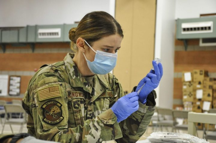 First Lt. Caleena Longworth, a 152nd Medical Group medical service corps officer assigned to Joint Task Force 17, prepares a syringe with the coronavirus vaccine at the Las Vegas Readiness Center, Jan. 27, 2021, in Las Vegas. (Air National Guard photo by Staff Sgt. Matthew Greiner)