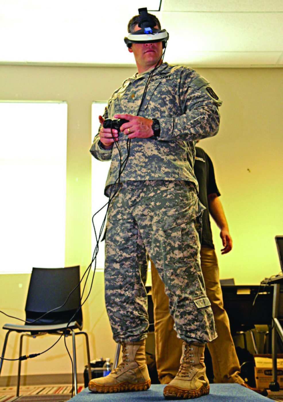 U.S. Army Maj. Ryan McCormack, an operations officer with the 17th Fires Brigade, tests the Bravemind interactive system at Joint Base Lewis-McChord, Washington, April 18, 2013. Bravemind is a virtual training system, designed by developers with the Institute for Creative Technologies, which is used to assess and treat post-traumatic stress disorder.
