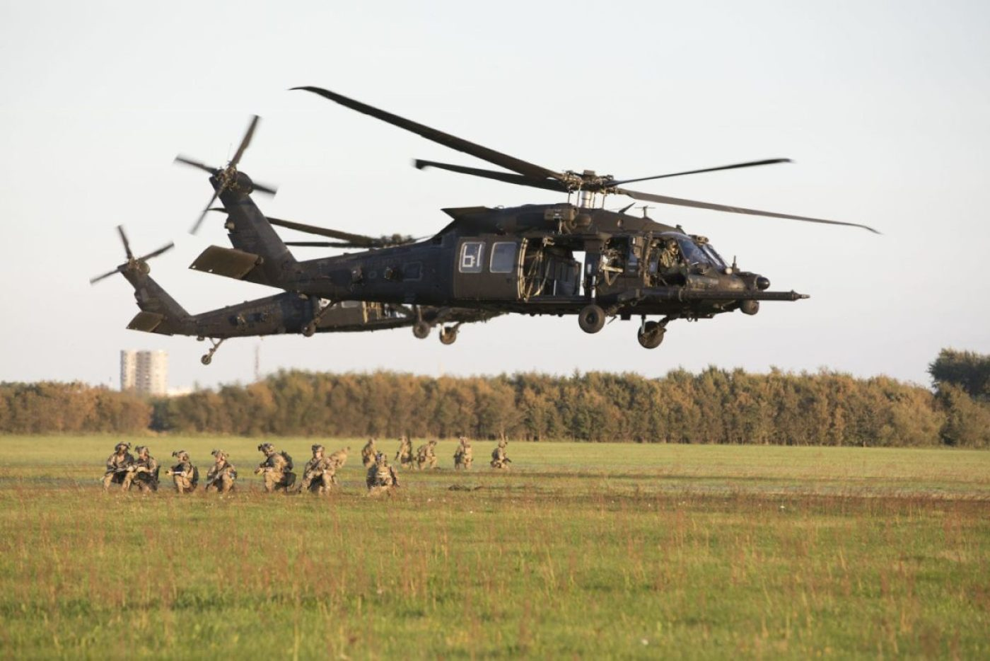 U.S. special operations forces assigned to the 10th Special Forces Group (Airborne) wait in formation after conducting fast rope maneuvers out of a UH-60 Black Hawk helicopter near Aalborg, Denmark, Sep. 02, 2018. (U.S. Army photo by Staff Sgt. Steven K. Young)