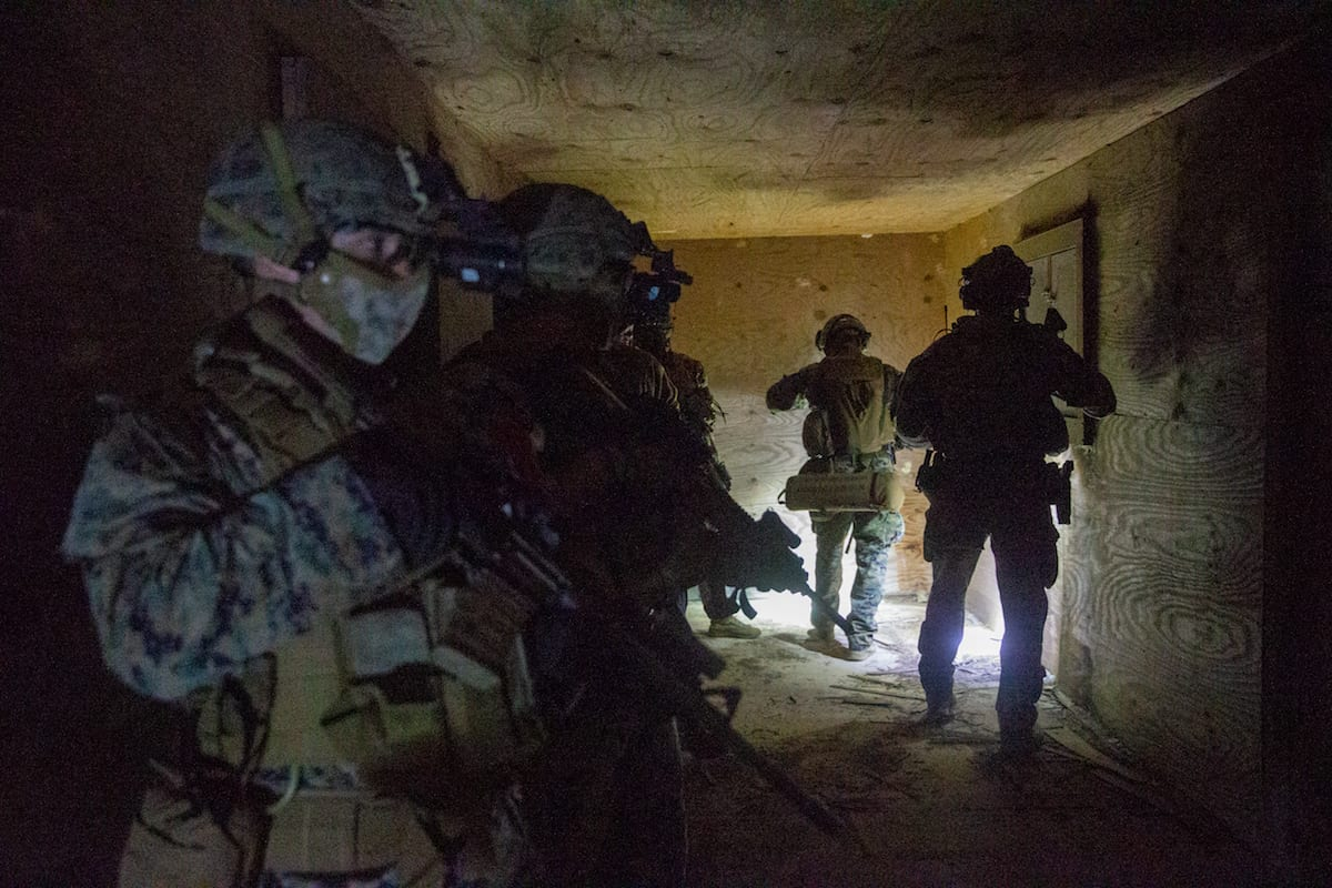 U.S. Marines with Bravo Company, 1st Battalion, 6th Marine Regiment, 2nd Marine Division, and with Alpha Company, 1st Marine Raider Battalion, Marine Forces Special Operations Command, clear a room during Exercise Raven 21-03 at Camp Shelby, Mississippi, Nov. 16, 2020. Bravo Company acted as a partner-nation force with which the Raiders integrated. MARSOC is in a unique position to act as a key connector to leverage and enhance the effects of the joint force and partner nations. (U.S. MARINE CORPS PHOTO BY LANCE CPL. JACQUELINE PARSONS)
