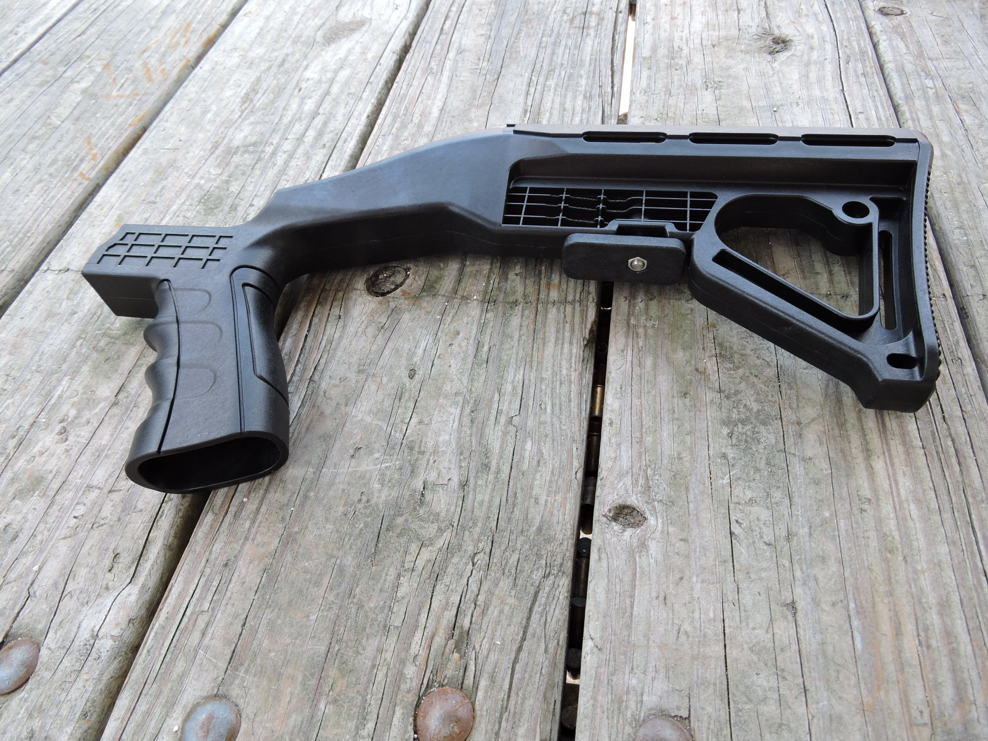 Image result for photos of bump stocks that turn guns into machine guns