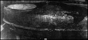 Col. William. Shy's cast iron coffin. Note the large hole to the right, presumably made by a tractor mounted post-hole digger which was used to probe the grave. Courtesy of the Tennessee Divsion, Sons of Confederate Veterans.