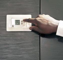 Adjusting thermostat.