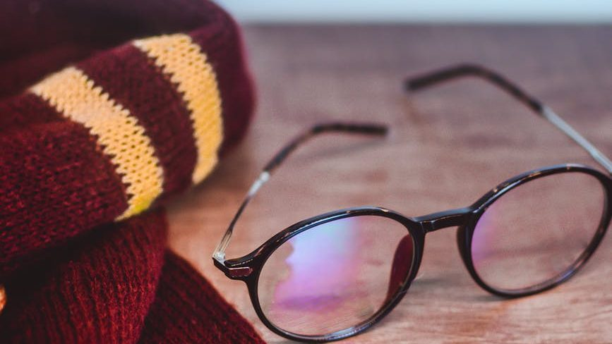scarf and eyeglasses on the table