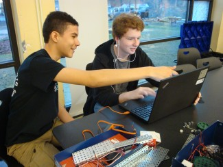 Two students on a laptop computer