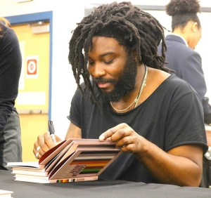 Best selling author Jason Reynolds Shares Stories with Lithonia High students