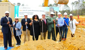 members celebrated the official opening of one elementary school and the groundbreaking of another
