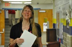 Nancy Balaun smiles in hallway