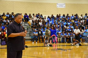 Jesse Jackson speaks with Cedar Grove High students in gym