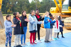 students perform at groundbreaking