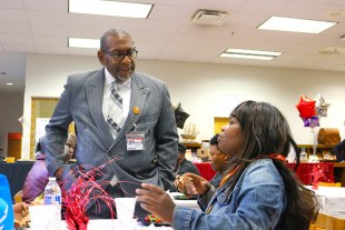 Dr. Green speaks with bus driver