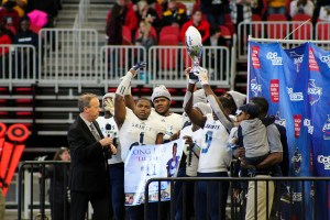 Cedar Grove football players hold up trophy
