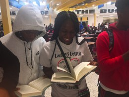 girl student reads open book