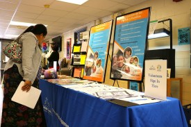 parent looks at resources on table