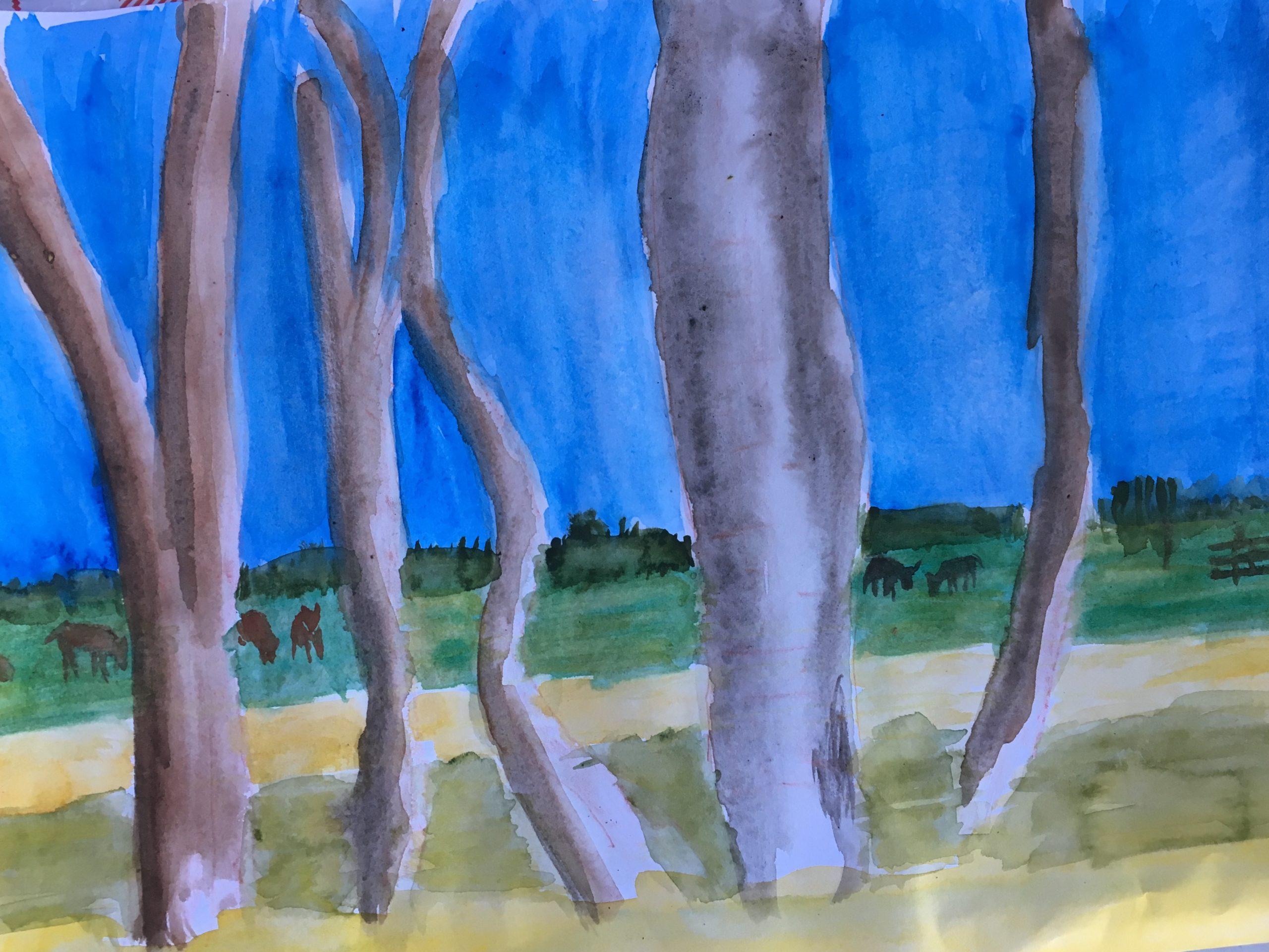 het uitzicht met bomen, weiland en koeien