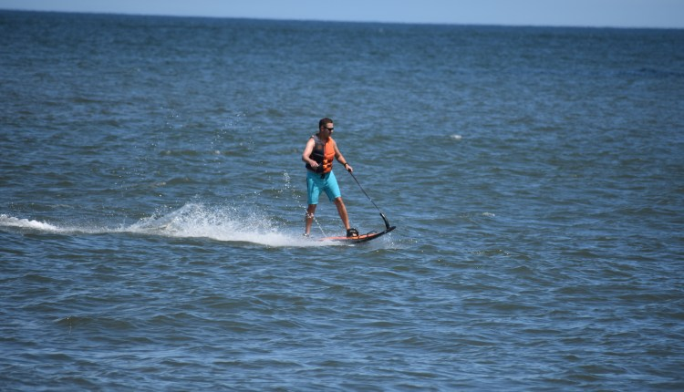 jet surf, Guy on a motorized  board off the beach in Cape Henlopen State Park
