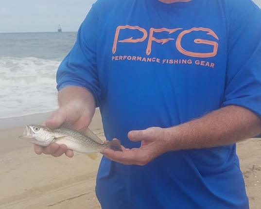Robb Kyons with a weakfish also known as a unicorn