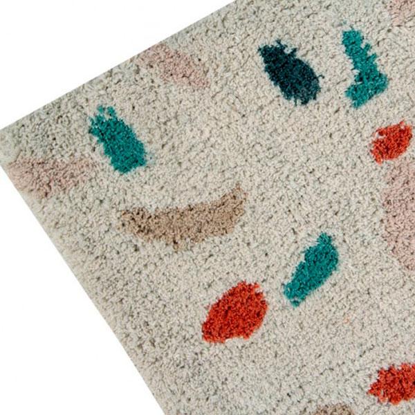 detalle de la alfombra lavable con estampado Terrazo de algodon de Lorena Canals